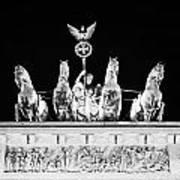 viktoria with quadriga on top of the Brandenburg gate at night Berlin Germany Poster