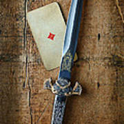 Vintage Dagger On Wood Table With Playing Card Poster