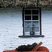 Wheelbarrow In Front Of A Window Of A Poster
