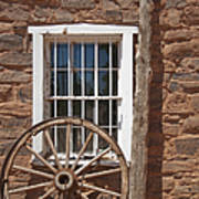 Window In Stone Building With Wagon Wheel Poster by Thom Gourley/Flatbread Images, LLC
