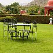 Wrought Metal Chairs Around A Table In A Lawn Poster