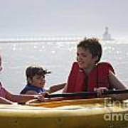 Young Kids Playing On A Kayak Poster