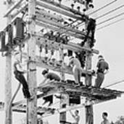 Young Men Working On Telephone Poles Poster