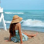 Young Woman Sitting On A Beach Poster