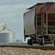 A Lone Grain Hopper Stands Idle On The Tracks Poster