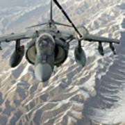 An Av-8b Harrier Receives Fuel Poster