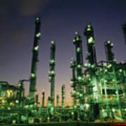 An Oil Refinery At Dusk Poster by Lynn Johnson