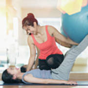 Asian Woman Fitness Coach Teach Her Student For Rubber Ball Exer Poster