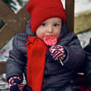 Baby In Red Hat Sits On A Bench In The Street With Candy Poster