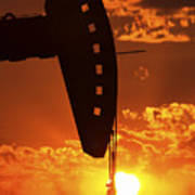 Oil Rig Pump Jack Silhouetted By Setting Sun Poster