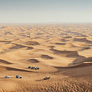One 4x4 Vehicle Off-roading In The Red Sand Dunes Of Dubai Emirates, United Arab Emirates Poster