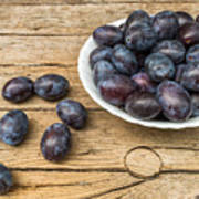 Plate Full Of Fresh Plums On A Wooden Background Poster