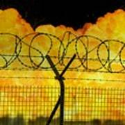 Realistic Orange Fire Explosion Behind Restricted Area Barbed Wire Fence Poster