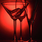 Three Empty Cocktail Glasses On Red Background Poster