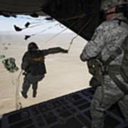 U.s. Airmen Jump From A C-130 Hercules Poster