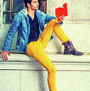 Young Man Reading Red Book, Sitting On Street Poster