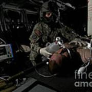 Flight Medic Looks After A Mock Patient Poster
