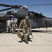 Pararescuemen Walks Away From A Hh-60g Poster