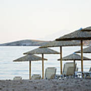 Parasol And Sunbeds At Sunset Poster