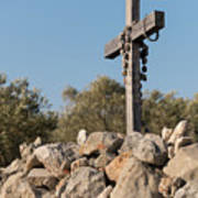 Rosary Hanging On A Small Wooden Cross On A Stone Wall Poster