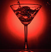 Cocktail Glass With Splashes On Red Background Poster