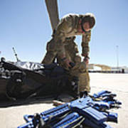 Pararescuemen Sorts Out His Gear Poster