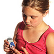 Diabetic Child With Blood Glucose Tester Poster
