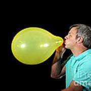 Man Inflating Balloon Poster