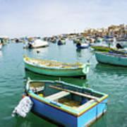 Traditional Boats At Marsaxlokk Harbor In Malta Poster