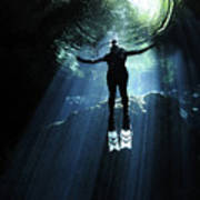 A Cavern Diver Ascends In The Cenote Poster by Karen Doody