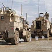 A Convoy Of Mrap Vehicles Near Camp Poster