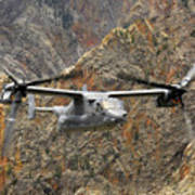 A Cv-22 Osprey Flies Over The Canyons Poster
