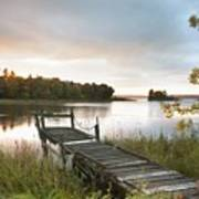 A Dock On A Lake At Sunrise Near Wawa Poster by Susan Dykstra