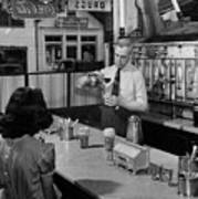 A Druggist Prepares Ice Cream Floats At A Soda Fountain Poster