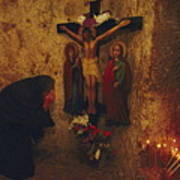 A Greek Pilgrim Prays In The Grotto Poster by Annie Griffiths
