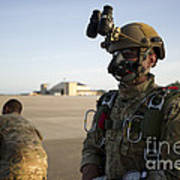 A Green Beret Waits To Have His Gear Poster