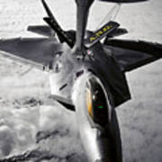 A Kc-135 Stratotanker Refuels A F-22 Poster by Stocktrek Images