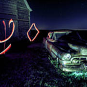 A Light Painted Scene Of A Rusty Caddy By A Barn And Cornfield Poster