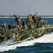 A Riverine Command Boat Conducts Poster