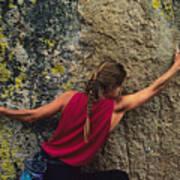 A Rock Climber On A Boulder Poster