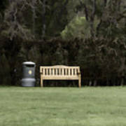 A Trash Can And Wooden Benches In A Small Grassy Area Poster