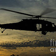A U.s. Army Uh-60 Black Hawk Leaves Poster