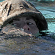 A U.s. Marine Swims Across A Training Poster