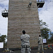 A U.s. Soldier Rappels Down A 40-foot Poster