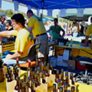 A Vendor At The Garlic Fest Offers Garlic Vinegar And Olive Oil For Sale Poster