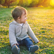 Adorable Baby Playing Outdoors Poster