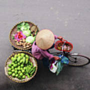 Aerial View Of A Vietnamese Traditional Seller On The Bicycle With Bags Full Of Vegetables Poster