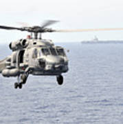 An Mh-60r Seahawk Helicopter In Flight Poster