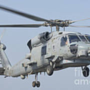 An Mh-60r Seahawk In Flight Poster