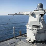 An Mk-38 Machine Gun System Aboard Uss Poster